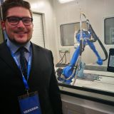 Out Technical Sales Representative, Benjamin Hlebec in front of Dry Ice robot cleaning procedure