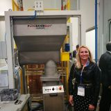 Our Managing Director, Mojca Andolšek in front of our machine